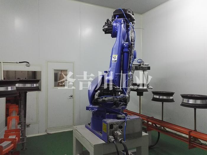 张家港铝轮毂底粉后待固化机器人两侧夹持转线机构